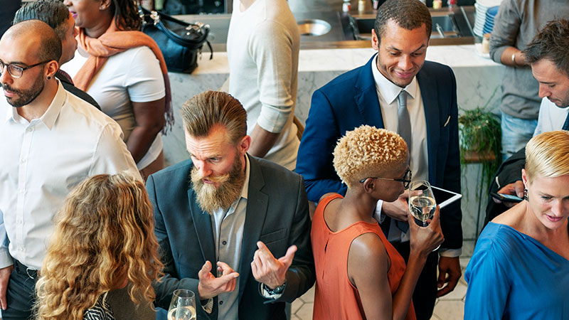 Diverse group of men and women at corporate party event